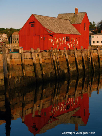 Reflection image of red barn at Cape Cod by Juergen Roth.