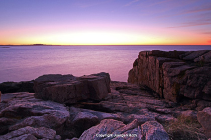 Image of twilight before sunrise on rock and water at Acadia National Park by Juergen Roth.