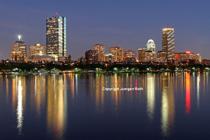 Twilight image of the city skyline and reflections in Boston by Juergen Roth.
