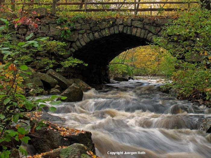 Image of a rock bridge over the rushing water of the Sudbury River by Juergen Roth.