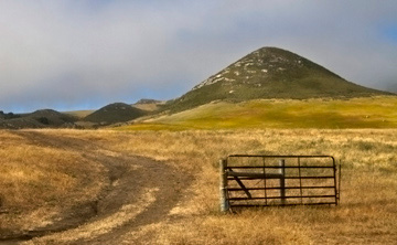 Landscape photo of old gate in prairie land of Los Osos, California by Noella Ballenger.
