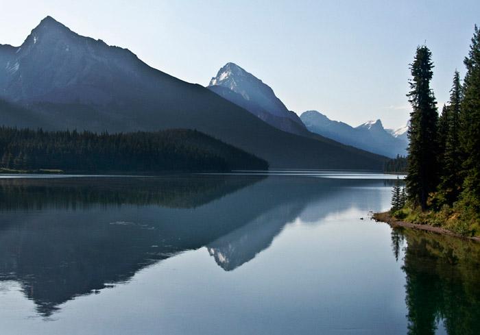 Landscape reflection photo of mountain range and lake in Maligne Lake, Alberta, Canada by Noella Ballenge