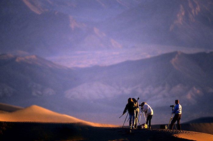 Landscape photo of photographers at and dunes & Funeral Mountains, Death Valley, California by Noella Ballenger