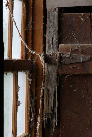 Photographing Historial Place: Window, cobwebs, latch and rope inside the barn at Kuerner Farm by Gary Anthes.