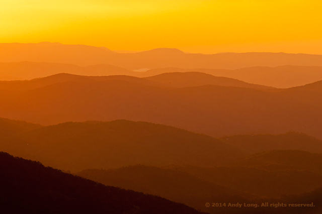 A foggy yellow, orange and red landscape image showing layers of lines and colors by Andy Long.