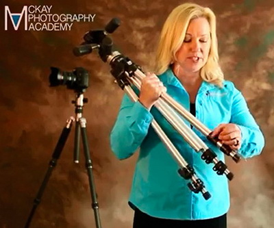Image of Ally McKay of McKay Photography Academy showing how to adjust tripod legs.