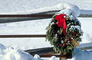 Photo of a snow capped wreath and fence in Wyoming by Brenda Tharp