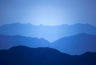 Ridges of blue mountains in Inyo Mountains, California by Noella Ballenger.