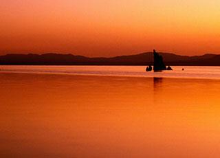 Orange glow of sunrise at Mono Lake, California by Noella Ballenger.