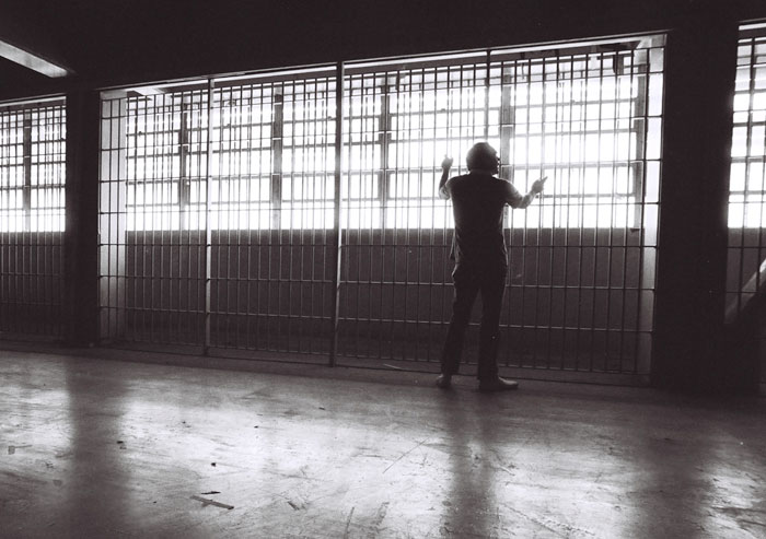 Silhouette photo of inmate at jail in Los Angeles, California by Ron Veto