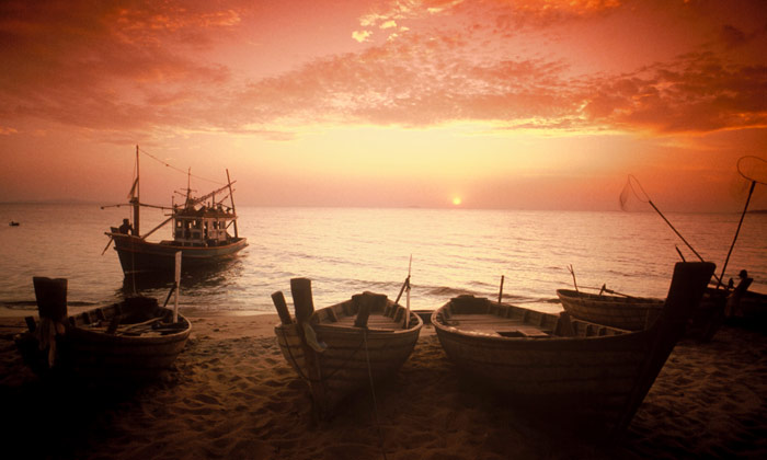 Partial silhouette photo of boats in Koh Samui, Thailand by Ron Veto