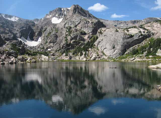 Photo adventures day hike: reflection of mountains on Blue Bird Lake, Rocky Mountain National Park by Jeff Doran.