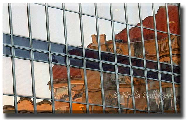 Reflection photo of mirrored buildings of an office building by Noella Ballenger.