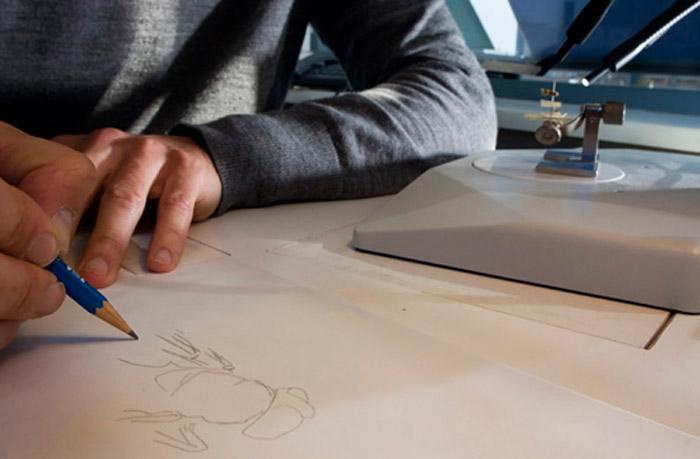 Photo of Erik-Jan Bosch, scientific illustrator, drawing insect by Edwin Brosens