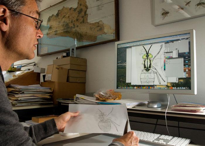 Photo of Erik-Jan Bosch, scientific illustrator, at computer by Edwin Brosens