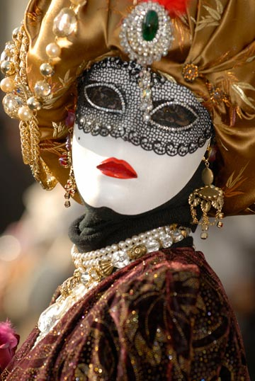 Photo of person in costume & mask at the Venetian Carnival by Piero Leonardi
