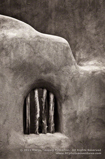 Photo of adobe wall in Taos, New Mexico by Margo Taussig Pinkerton