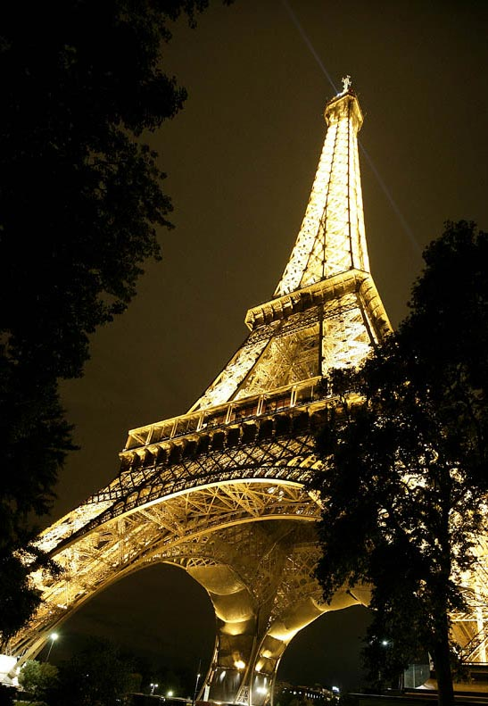 Night photo of the Eiffel Tower in Paris by Andy Long