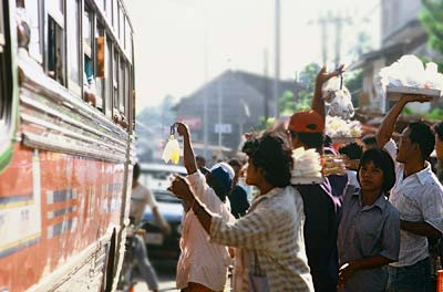 Photo of hawkers selling food outside of bus by Ron Veto