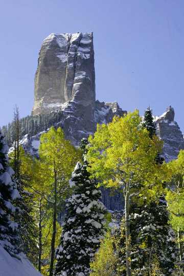 Photo of rock formation, green Aspen leaves and snow by Andy Long