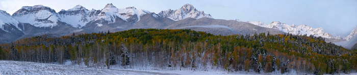 Panorama photo of mountain in winter by Andy Long
