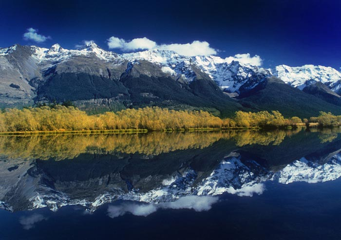 Water reflection photo of mountains at Lake Wakatipu in Glenorchy, New Zealand by Noella Ballenger