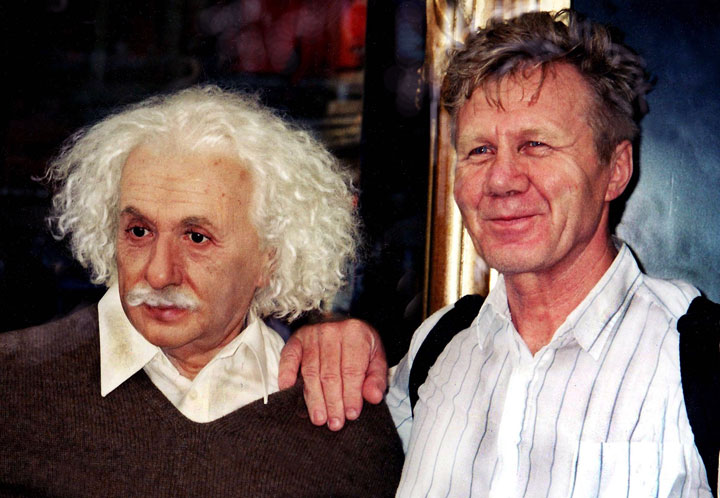 Photo of a wax Einstein next to a tourist in New York by Ned Harris.