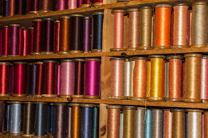 Photo of colorful yarns storaged on spools at West Coast Trimming by Noella Ballenger