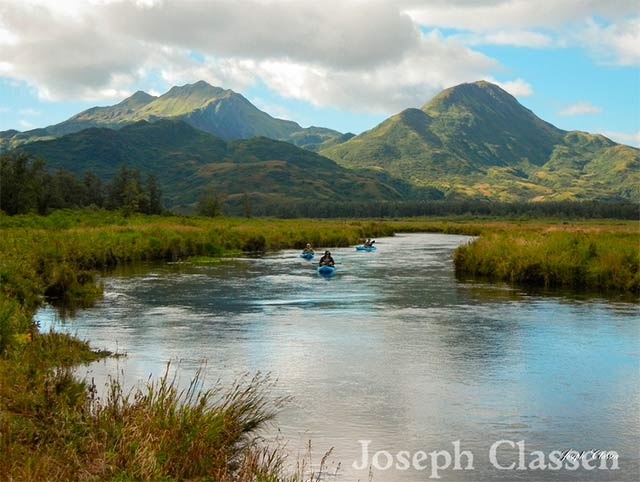 Kayakers go for a peaceful paddle on the waters of Eagle Harbor. Kodiak Island, Alaska by Joseph Classen.