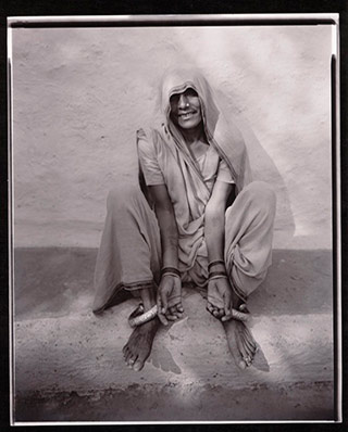 Black and white photo portrait of a Hindu woman with tatoos in Asia by Linda Connor.
