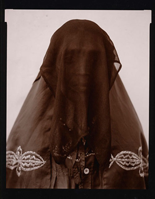 Black and white photo portrait of Veiled Woman in India by Linda Connor.