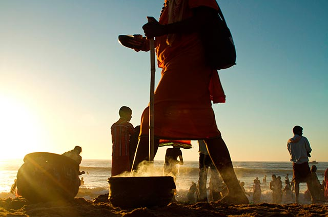 Dasara festival in India: Beach scene where devotees leave the Holy torch laying in the sand by Kris Hariharan.