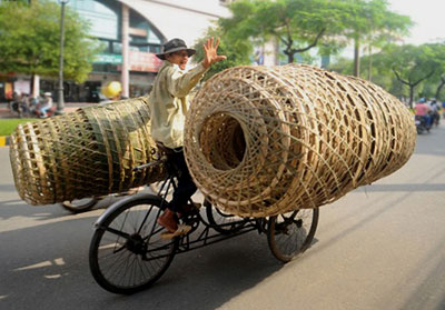 Photo of of man and baskets in Saigon, South Vietnam by Ron Veto
