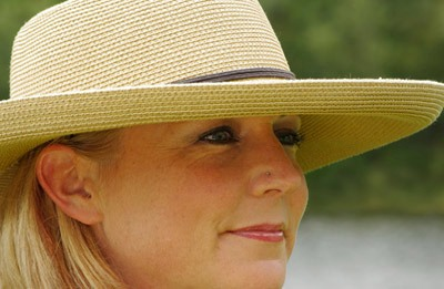 Close-up portrait of woman with hat using Lastolite Sunlite reflector by Marla Meier
