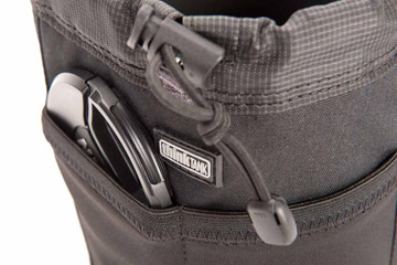 Photo showing stretch pocket on the front of modular pouch by Think Tank Photo