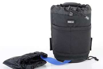 Photo showing rain cover attached to the bottom of modular pouch by Think Tank Photo