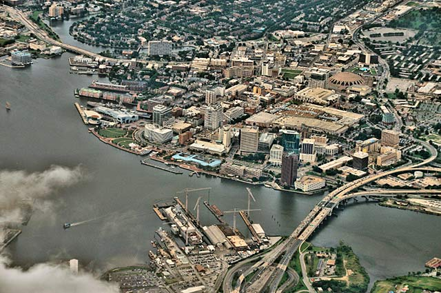 Aerial photo of the city and river along downtown Norfolk, Virginia by Allen Moore.
