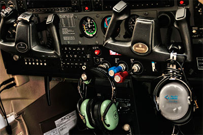 Aerial photography: image of the cockpit of a Cessna 182 by Allen Moore.