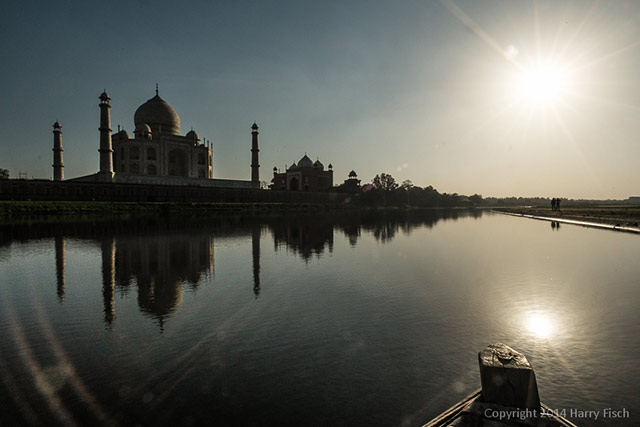 A view of the Taj Mahal from a boat on the River - Agra, India by Harry Fisch.