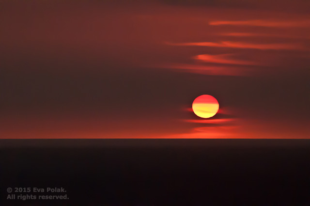 Image of sunset over water showing contrast in shape by Eva Polak.