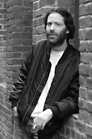 Black and white photo portrait of man by Monica von Stackelberg