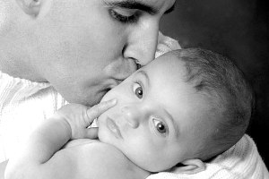 Black and white photo portrait of father and baby by Monica von Stackelberg
