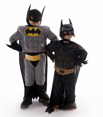 Children dressed up in Batman costumes for Halloween by Brad Sharp.