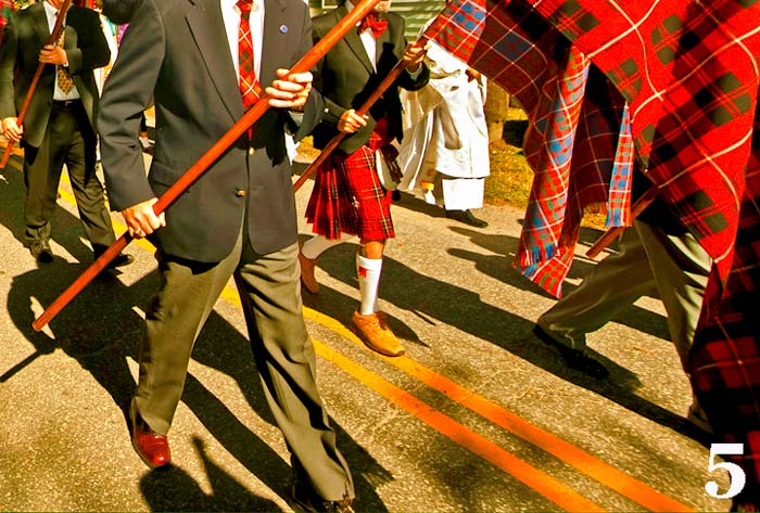 Photos of people in kilts during a parade by Jim Austin