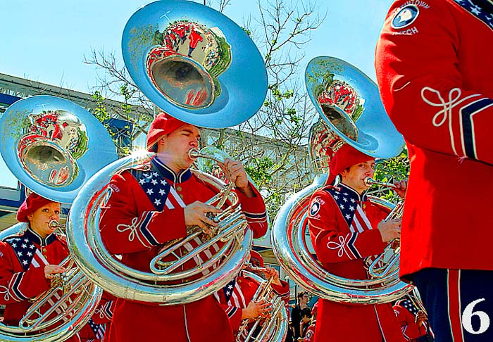 Photos of tubas in a marching band during a parade by Jim Austin