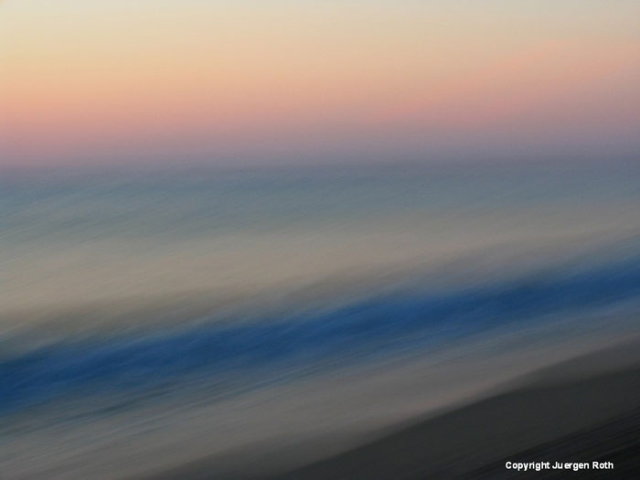 Intentional horizontal camera movement: image of seascape at sunset with pastel colors by Juergen Roth.