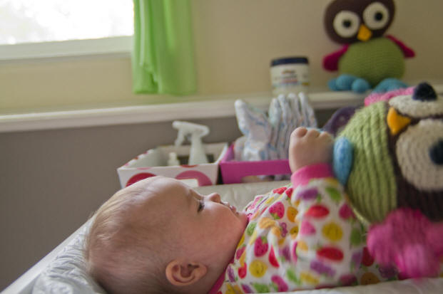 Image of Baby A playing with her stuffed owl early in the morning by Elizabeth Powis Fulks.