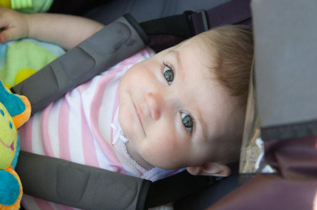 Photo of Baby A looking up from her car seat by Elizabeth Powis Fulks.