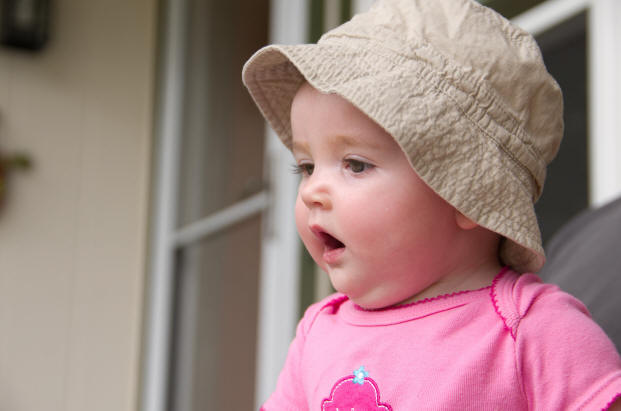 Image of Baby A in her hat and pink shirt by Elizabeth Powis Fulks.