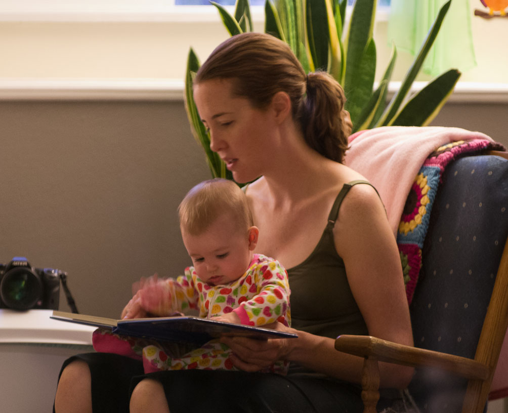Mom and Baby A reading a book before bedtime by Michael Fulks.